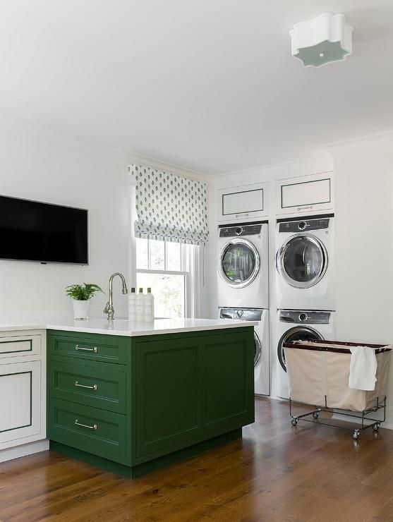Green Laundry Room Island Featuring A Sink With A Gooseneck Faucet