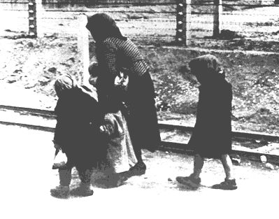 A mother and children on their way to the gas chambers. Source: Dachau Memorial Museum.