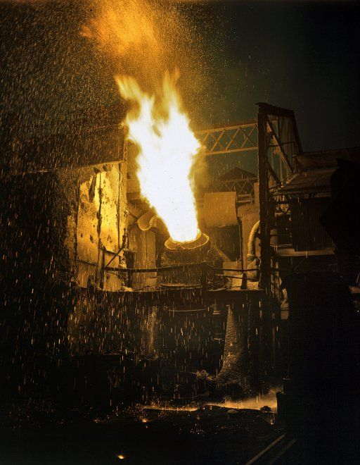November 1941. Eastern Bessemer converter at Republic Steel in Youngstown, Ohio. Molten iron is charged with air to change it into steel for war essentials.