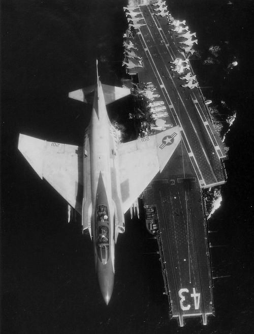 An F-4N Phantom II of Fighter Squadron (VF) 21 pictured in flight over the carrier Coral Sea (CV 43) in 1983. (Source)