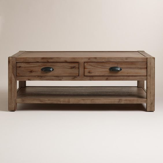 Our coffee table is a rustic addition to your living area with a chunky wood frame and metal library-style drawer pulls. It offers two drawers for organizing knickknacks and a lower shelf for storing books and magazines.