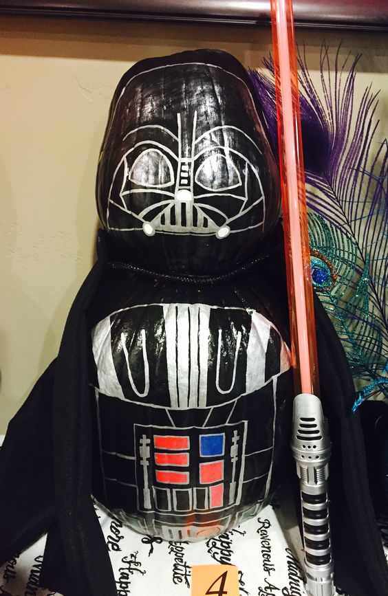 Darth Vader Pumpkin Decorating Idea for Halloween. I used Metallic Tole Paint for the Black, Red, Green and Blue colors. I used a Silver Sharpie to do the fine lines and all Silver on the Darth Vader. Star Wars Pumpkin Decorating is Awesome!