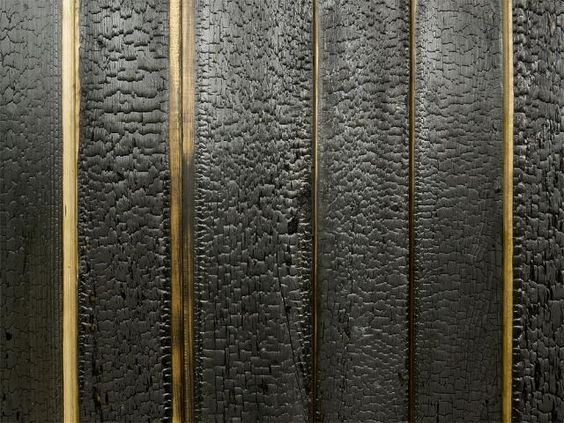 This cladding has been charred, a traditional Japanese method of preserving timber without the use of chemicals.