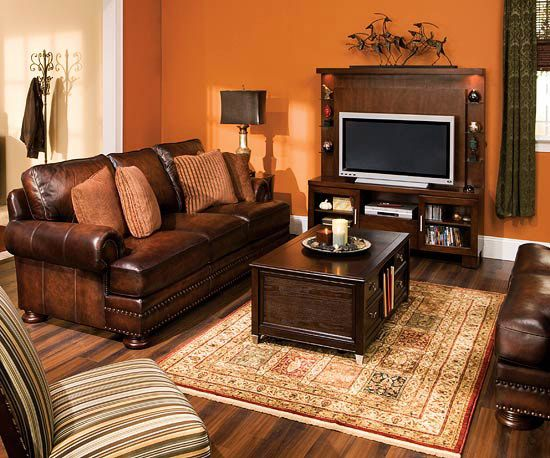 Stylish living room collections from raymour flanigan wall colors dark wood and accent pillows for Chocolate and orange living room