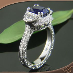 Antique style 3-Stone with half moon diamonds