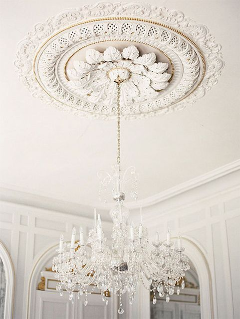 Beautiful Elaborate Victorian ceiling rose with a crystal chandelier hanging from it...x: