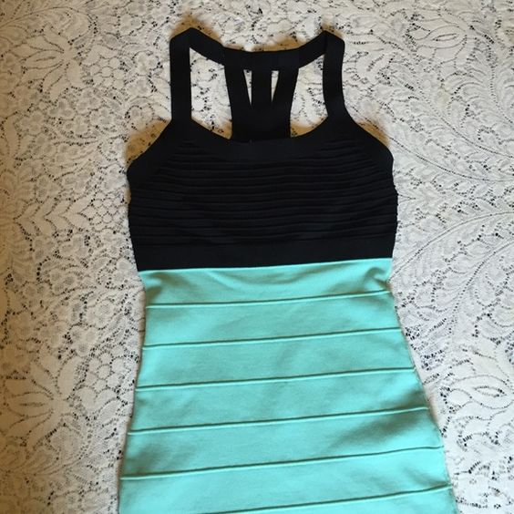 Sliming teal mini dress I absolutely love this dress! It's very slimming and has black strappy detail in the back. Forever 21 Dresses Mini