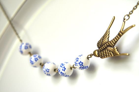 White & Blue Bird Necklace - Sparrow, Antique Brass, Like Polish Pottery, Porcelain, Ceramic, Diving Swallow. $18.00, via Etsy.