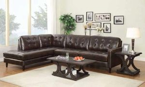 Brown Leather Sectional in Chicago, IL (sells for $1,200)