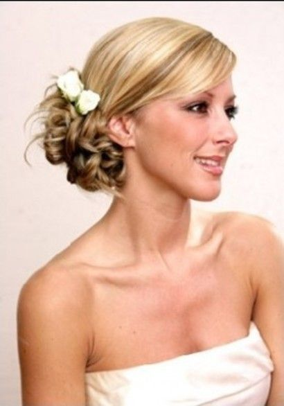 i like the swept look to the side with the curls...just an idea... :) pretty
