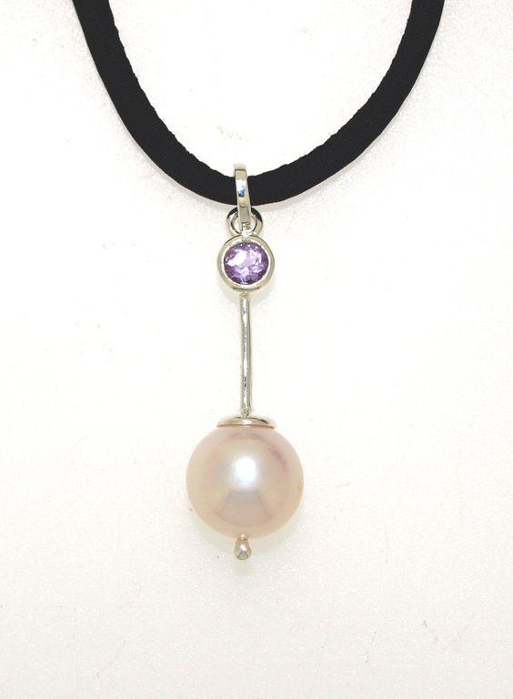 Freshwater pearl, amethsyt and sterling silver pendant on black silk $245  www.randbsutherland.com.au #sterlingsilver #pearl #amethyst #pendant #jewellery  #randbsutherland #clarevalley