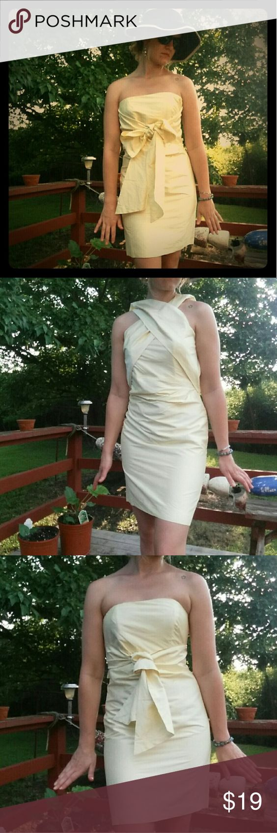 """Strapless yellow semi-formal with unique sash Semi-formal yellow 100% silk dress with unusual attached sash that can be styled several different ways. ***Please Note*** this dress has been machine washed, dry-cleaned, and pressed all in attempt to remove a very light lipstick stain under the sash... so it is washed and pressed silk and looks like it. Price is """"as is"""". Coren Moore Dresses Strapless"""