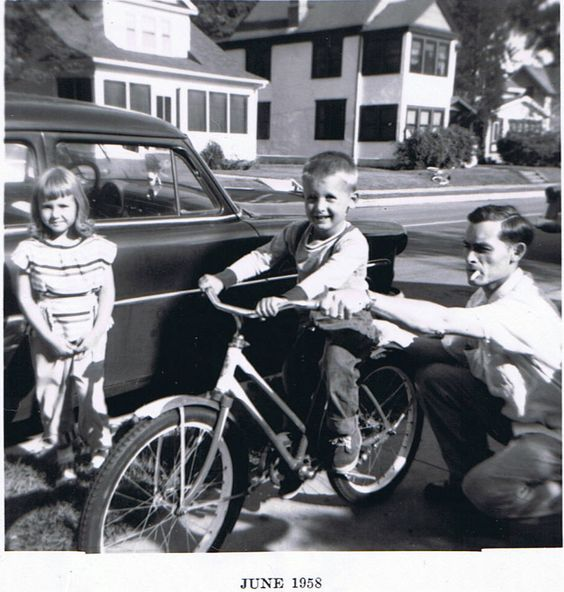 I love this pic of my Dad teaching my Brother how to ride his bike!