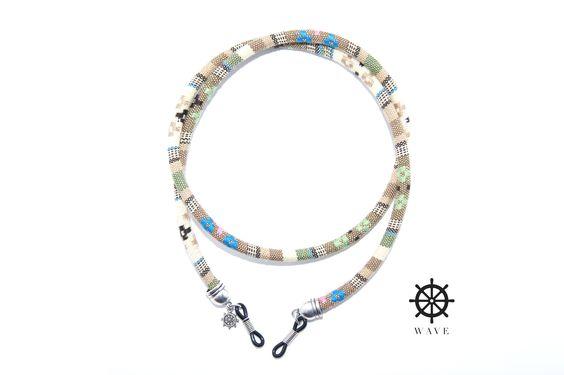 Cuelga gafas Amazonas. Cordón redondo de algodón, con terminaciones metálicas y gomas adaptables.
