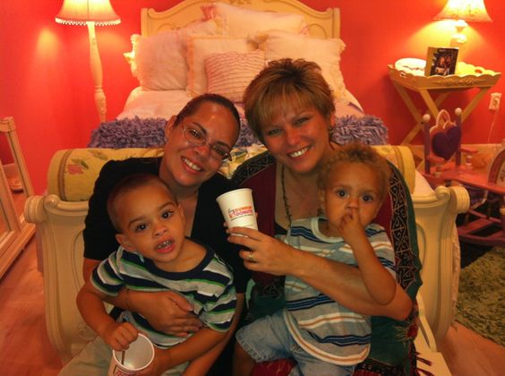 Kimberly West, Emily Prosser & her two little ones sporting the Dunkin' Donuts cup. #takeflight