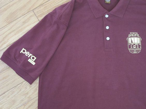 Another view of the Pera Soho shirt with logo on sleeve we designed for their staff this summer.