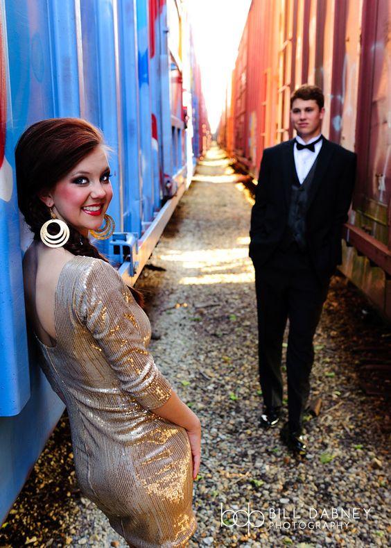 formal fashion prom seniors couple railroad tracks train tux tuxedo glamour