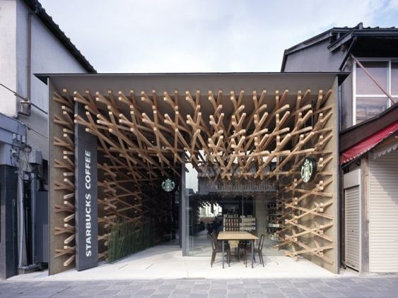 Starbucks - Japanese architect Kengo Kuma has designed a sculptural interior for the coffee chain to sit inside plain box-shaped structure.