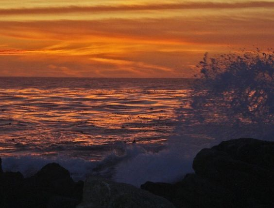 red sunset with crashing wave foreground