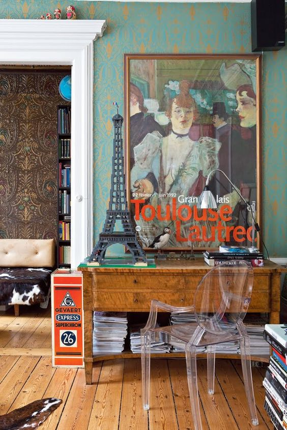 Eclectic foyer... the  table with ghost chair and teal wall  along with accessories and the art
