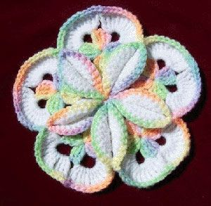 Use a free crochet pattern like this one to make a starburst hotpad. The design is really neat and the colors are fresh. It almost looks like a tie-dye pattern.