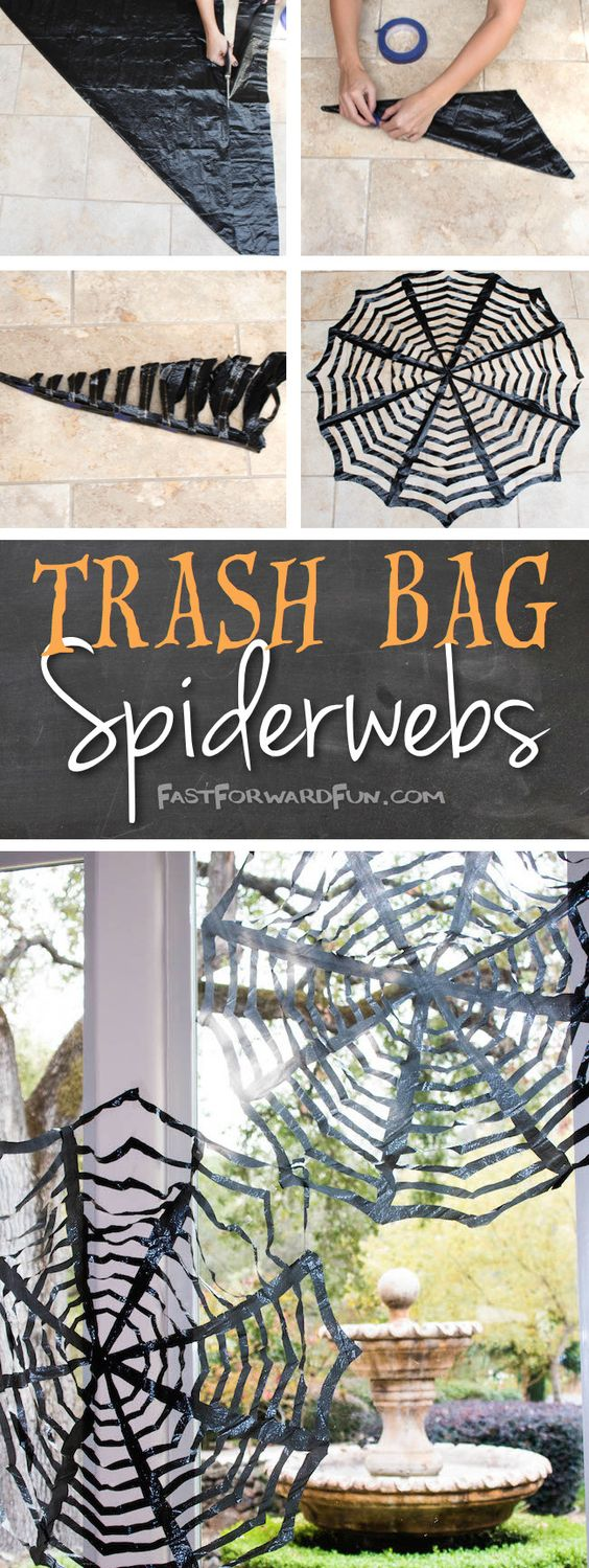 Cut (clean) trash bags into oversized spider webs just like you'd cut a holiday snowflake.