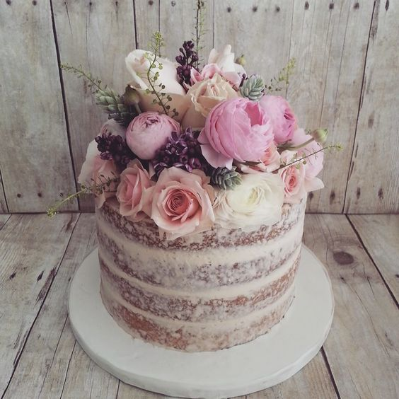 naked cake with fresh floral topper the cocoa cakery
