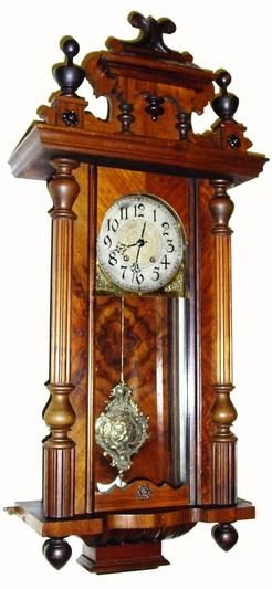 From Germany, An antique circa 1875 German Lenzkirch, fancy walnut wall regulator clock having a spring driven time and strike movement.  The silvered dial has an embossed and gilded center. The best part is a fantastic cast bronze pendulum in rococo style with a winged cherub in the center.