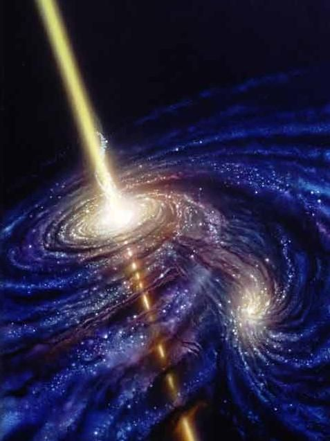 A Black hole spewing its energy deep into space. Its called a gamma ray burst.  Awesome.  Dr. Sheldon Cooper would be proud...