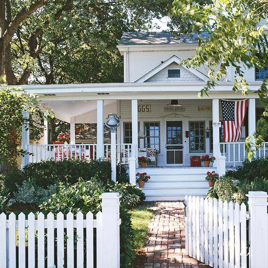 We love the timeless look of a white wraparound porch.