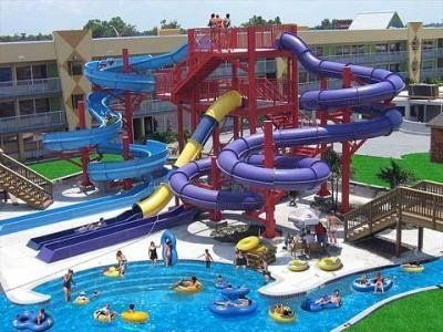 Clarion Resort And Waterpark, Kissimmee, FL. $49. Get a gander of the water park with heated lazy river, large swimming pool, 30-foot tower, several thrilling slides, and an interactive water play area. While the kids wear themselves out, adults can sip a cool cocktail from the poolside bar next to a waterfall, or soak in the spa tub. The resort also has a restaurant, lounge, ice cream shop, fitness center, gift shop, 24-hour business center, laundry facilities, and self-parking.