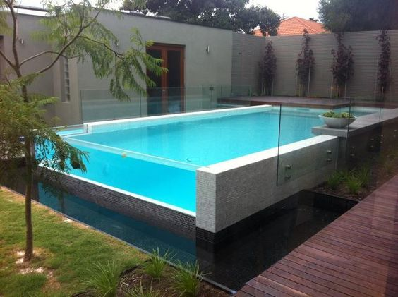 Thick glass pool wall ideas for the house pinterest for Glass swimming pool