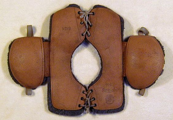 1910's Vintage Leather Football Shoulder Pads by Reach. The offered vintage football shoulder pads were made by the A.J. Reach Sporting Goods Company from Philadelphia, PA. They are a wonderful example of the bare minimum pads that were worn by football players from this era. Some still chose not to wear any pads at all! This particular pair has survived nearly a decade in amazingly excellent condition. The leather remains soft and supple and the compressed felt padding is also nearly perfect. B: Felt Padding, Football Players, American Football, Vintage, Football Equipment, Leather, Football Pads, Football Shoulder Pads