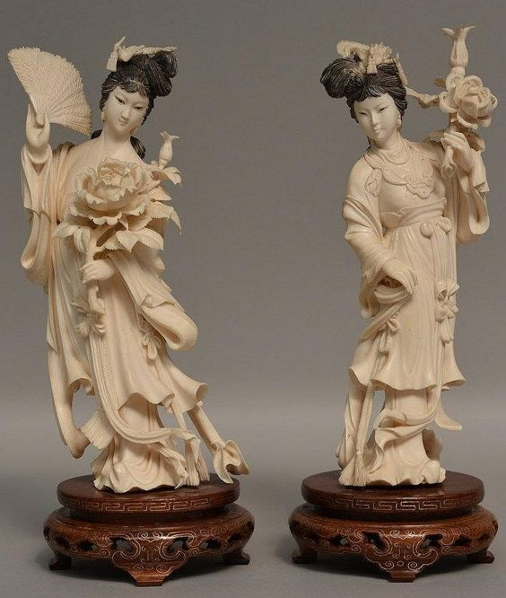 Two ivory Chinese beauties on wooden bases, first half 20thC