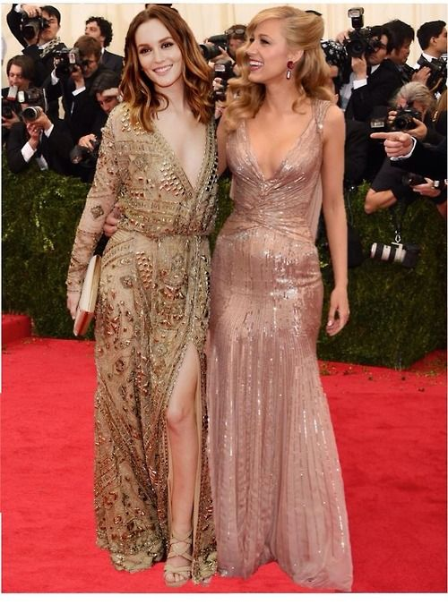 Love the perfect blush shimmery color of the dress on the right, stunningly elegant