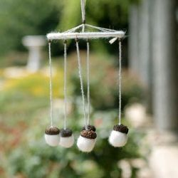 An idea of a wedding decoration came up to my mind after I created a set of felted acorns. Why not to try arrange them into a wind chime?