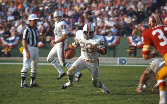 Mercury Morris runs against the Washington Redskins in Super Bowl VII. (Focus on Sport/Getty Images)  The Dolphins went 17-0 and capped off their season with a 14-7 victory over the Washington Redskins in Super Bowl VII.  Headed to the White House 40 years later to celebrate with President Obama!