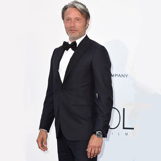 boucheron: For the annual amfAR gala reception actor and member of the Jury Mads Mikkelsen wore an Epure Chronographe watch in steel with a black alligator strap. #Cannes2016 #Boucheron #BoucheronRedCarpet #BoucheronEpure #AmfarCannes