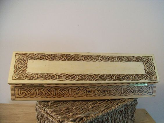 Wooden box decorated with Celtic designs.
