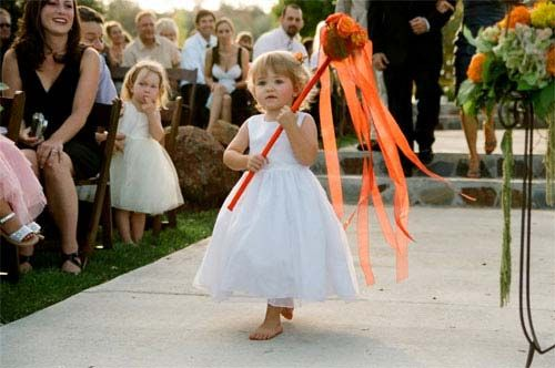 """Ribbon wands are easier for little kids to hang onto.  Plus they are much less fragile than fresh flowers.  Or those """"gymnastic"""" ribbons"""