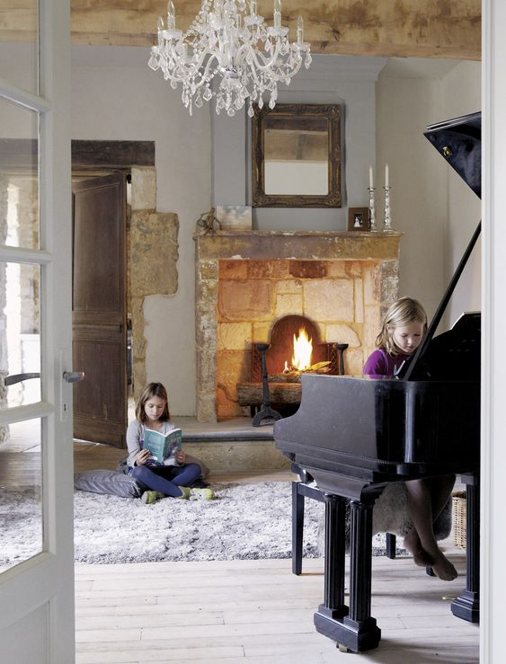 French country farmhouse decor: Roses and Rust: French Farmhouse living room. cozy fireplace beautiful baby grand piano & comfy rug to read a book on. #frenchfarmhouse #frenchcountry #decor #oldworld #provence #fireplace