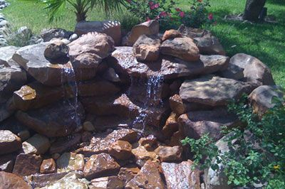 Beautiful water feature I'd love for my backyard!