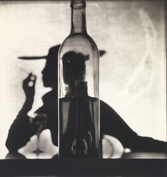 Irving Penn, Girl Behind Bottle (Jean Patchett), New York, 1949