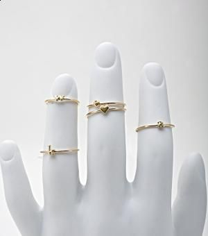 catbirdnyc - alphabet rings.     Love that they're stackable. I'd get two or three (the heart one is a must!) and wear them on my middle finger. Adorable.