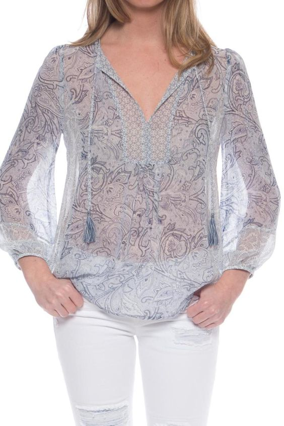 The Acerila blouse from Joie features an easy breezy silhouette that makes it perfect for Spring.  Subtle paisley print garnishes throughout this silky sheer blouse.  Fun tassel ties provide a refreshing understated bohemian vibe.  Wear this top with your skinny white distressed denim from J Brand and 3.1 Phillip Lim sandals. Acerila Blouse by Joie. Clothing New Jersey