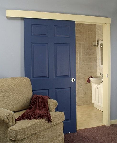 Johnson Hardware.  Space saving, like a pocket door, but the door stays on the outside of the wall.