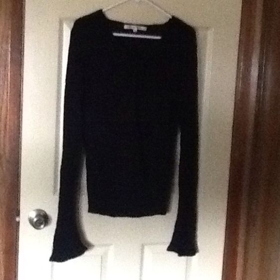 Clearance Sale Studio M Sweater Sweater is Black in Color. It has a tie closure in front of sweater. Has a design towards the bottom. It has long sleeves. Price is firm. Studio M Sweaters Cardigans