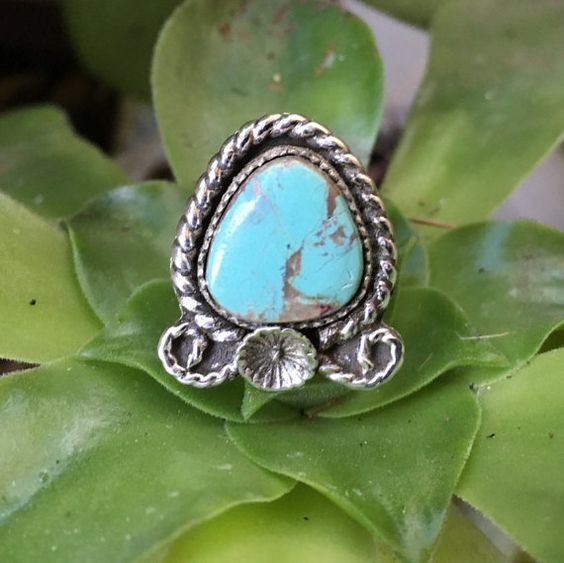 Lovely and feminine, handmade sterling silver flower ring with Kingman turquoise. Ring is a size 5.75  The Kingman turquoise cab has a unique