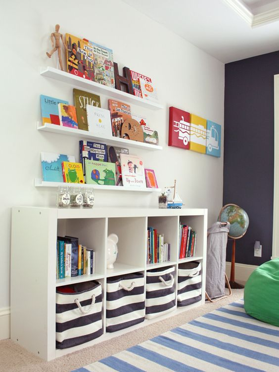 Great storage ideas for a kids room - the @IKEAUSA Expedit Bookcase + @LandofNod striped bins are a match made in heaven!: