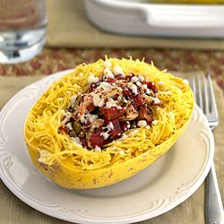 Spaghetti squash stuffed with tomatoes, olives and chicken, topped with feta. Ready in less than 20 minutes